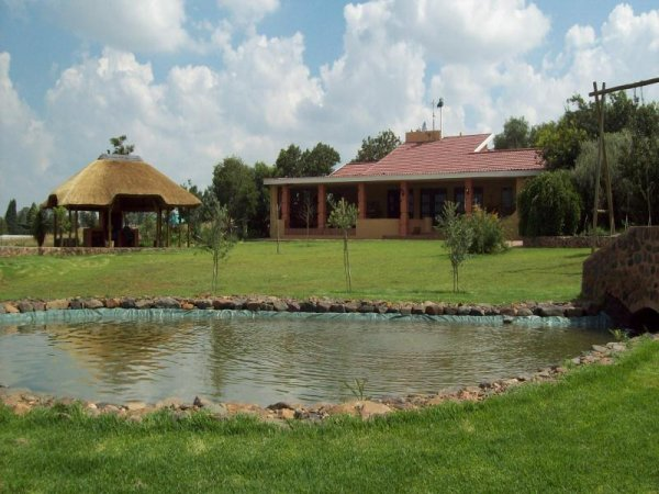 A fully furnished and fitted self-catering four bedroom unit with DSTV, 'River Lodge' can comfortably accommodate three couples (double beds) and 6 singles in stacked bunk beds (12 guests in total). [Provision can be made for up to 4 extra single guests a