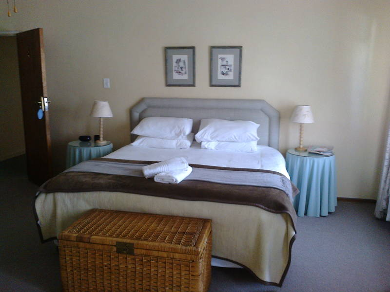 Room 2: king size bed, sitting area.